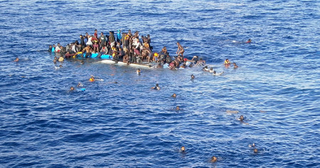Refugees in a boat in the Mediterranean.