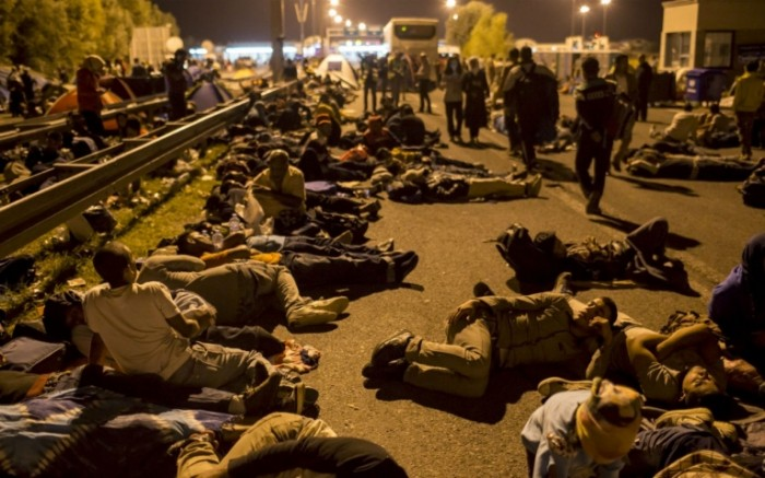 Refugees sleeping in the streets of Hungary.