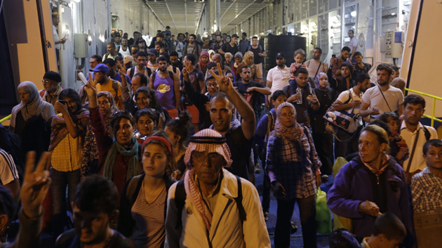 Syrian refugees arrive at the Athen's port of Piraeu.