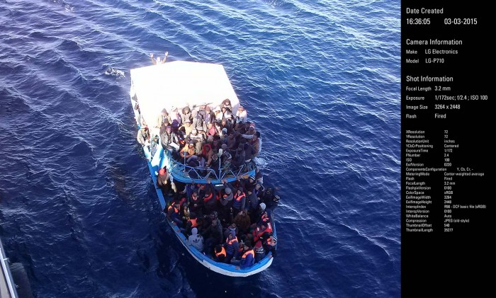 Migrants or refugees in a boat. One of a few photographs taken by the crew of the OOC Cougar (rescue ship) as the migrants' boat capsized upon approaching the ship that was attempting to rescue it.