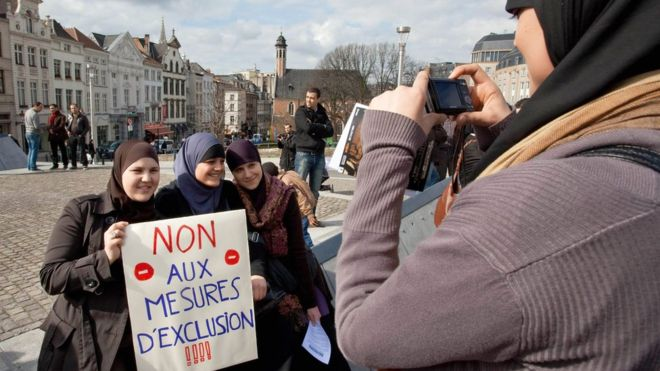 Picture of some Muslim women in Belgium who are protesting against restrictions on wearing headscarves.