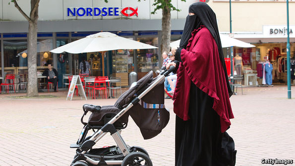 Picture of a veiled woman walking on the street with her child in a stroller in Germany