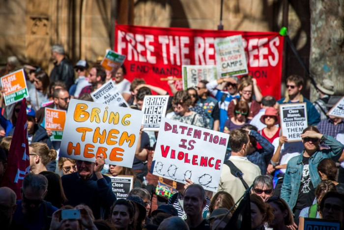 A picture showing protesters in Sydney against the country's detention policy for asylum seekers and refugees.