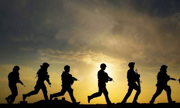 Picture of British soldiers walking in a line in Afghanistan