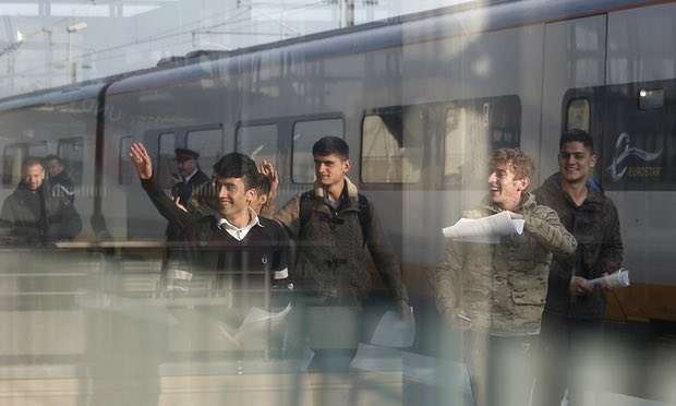 Five children are shown on the dock coming out of a train