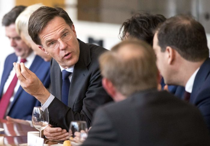 Picture showing Mark Rutte of the Netherlands discussing with colleagues at The Hague