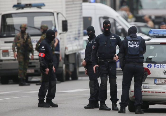 Picture showing a group of masked and armed policeman preparing for an anti-terrorist operation